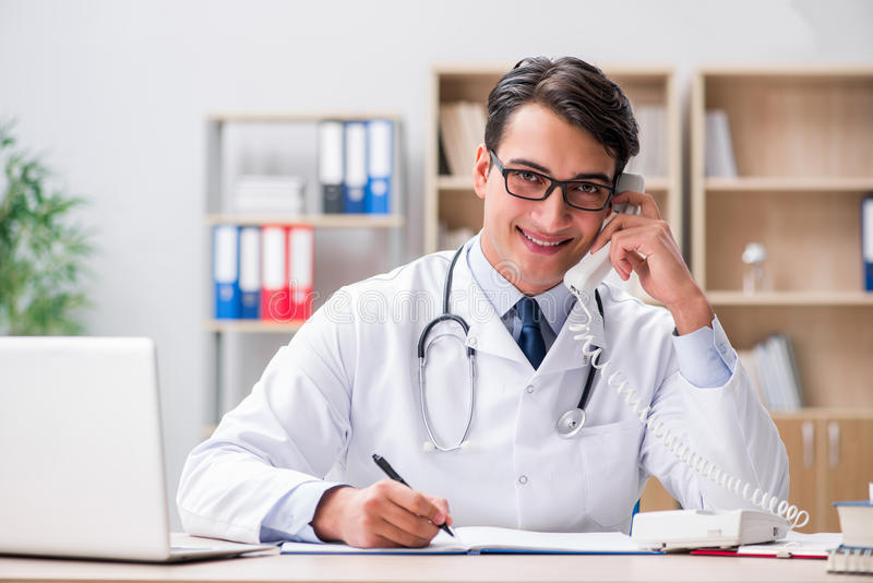 The doctor consulting patient over the phone. Doctor consulting patient over the phone royalty free stock photography