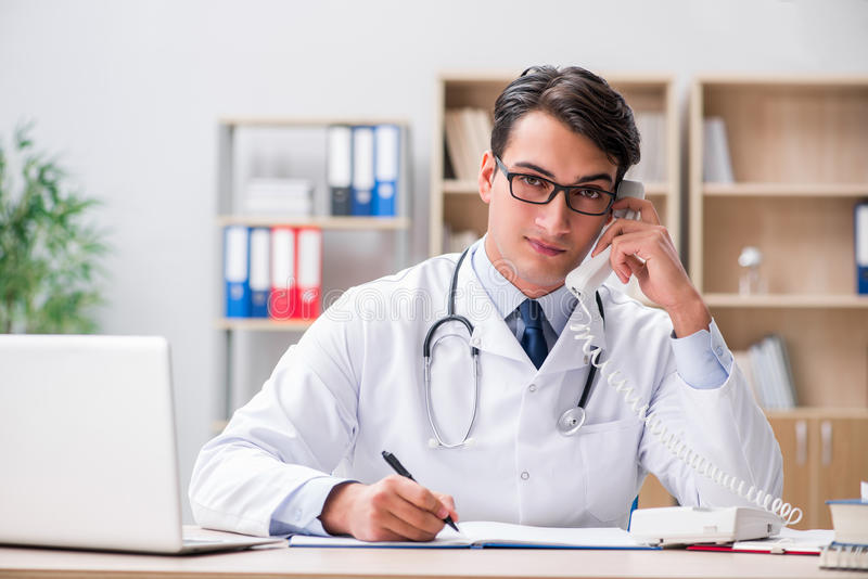 The doctor consulting patient over the phone. Doctor consulting patient over the phone stock photos