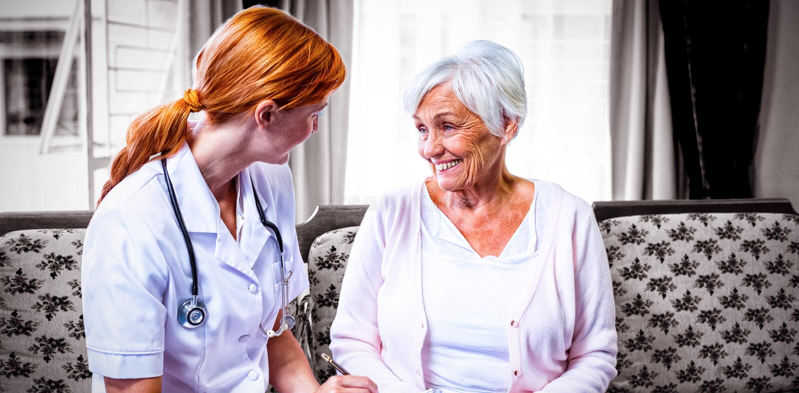 Doctor consulting with senior woman. Doctor consulting with senior women at home royalty free stock images