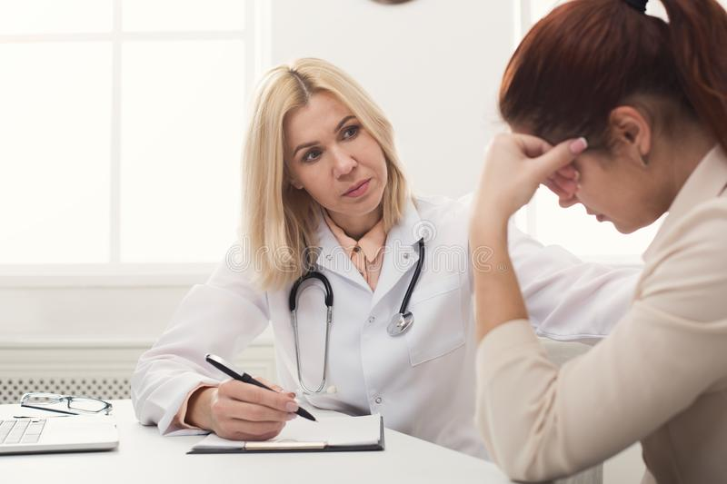 Doctor consulting woman in hospital royalty free stock photo