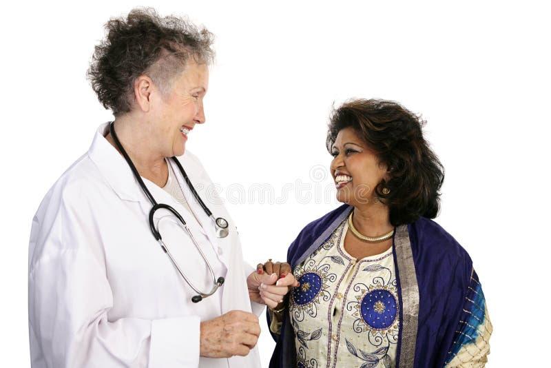 Doctor cooperación paciente fotografía de archivo libre de regalías