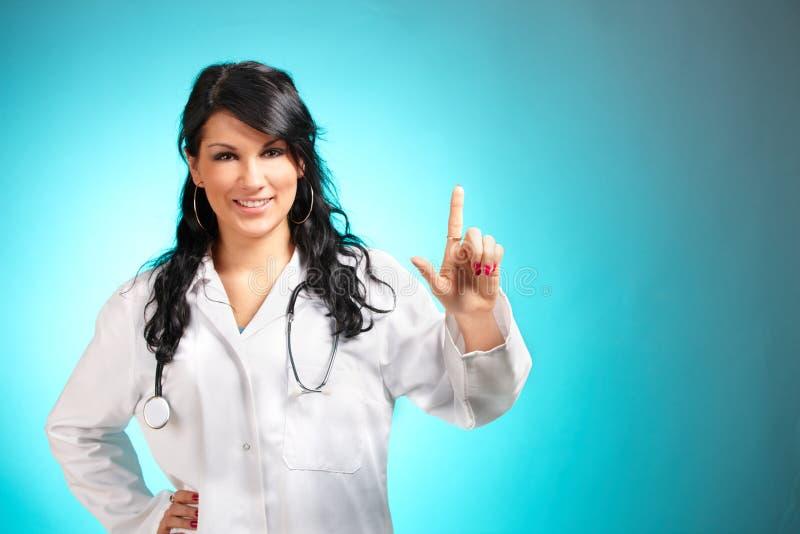 Doctor de la medicina que señala en algo imagen de archivo