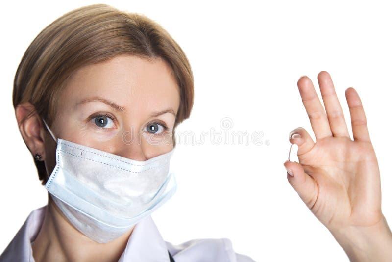 Doctor de la mujer con una píldora fotografía de archivo