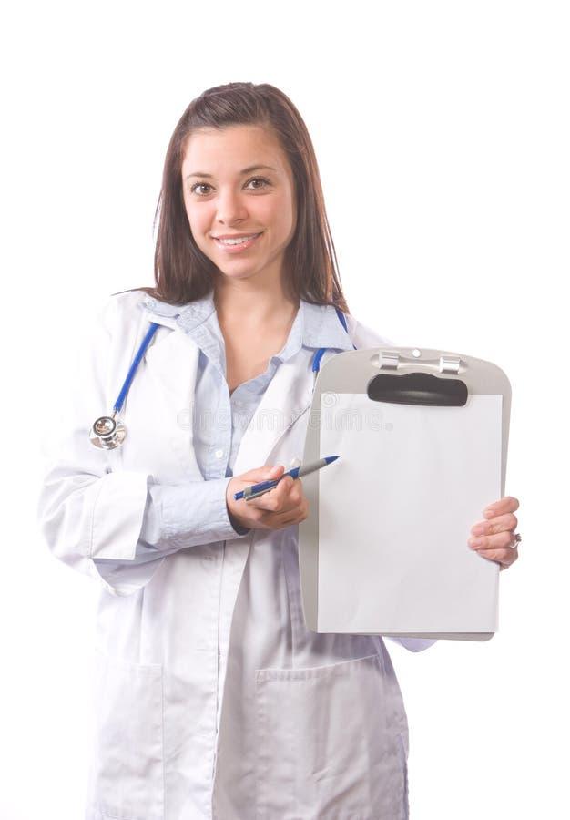Doctor de sexo femenino aislado en blanco foto de archivo