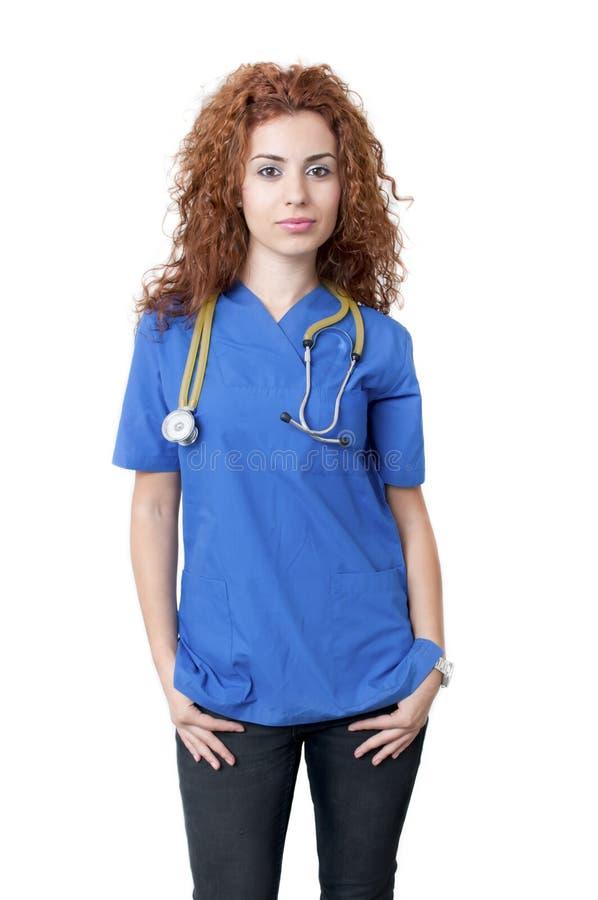 Doctor de sexo femenino en uniforme azul imagenes de archivo