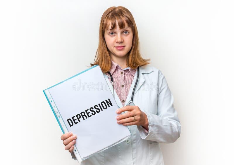Doctor de sexo femenino que muestra el tablero con el texto escrito: Depresión fotografía de archivo