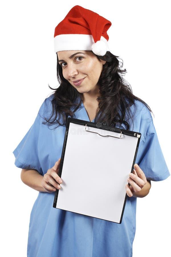 Doctor de sexo femenino que sostiene el sujetapapeles imagenes de archivo