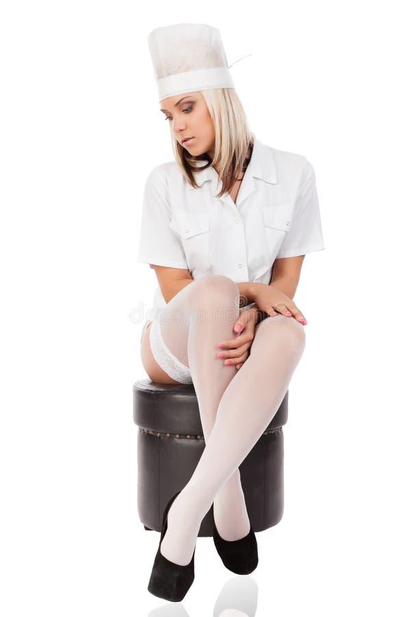Doctor de sexo femenino sexual joven imagen de archivo