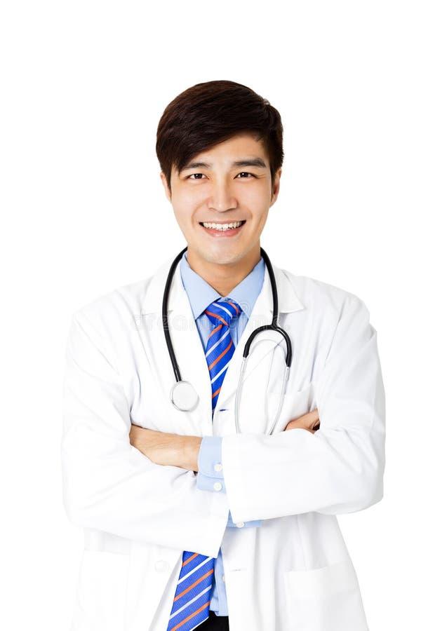 Doctor de sexo masculino joven aislado en blanco imagenes de archivo