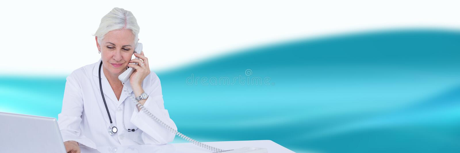 Doctor at desk on phone against blue and white blurred abstract background. Digital composite of Doctor at desk on phone against blue and white blurred abstract stock photos