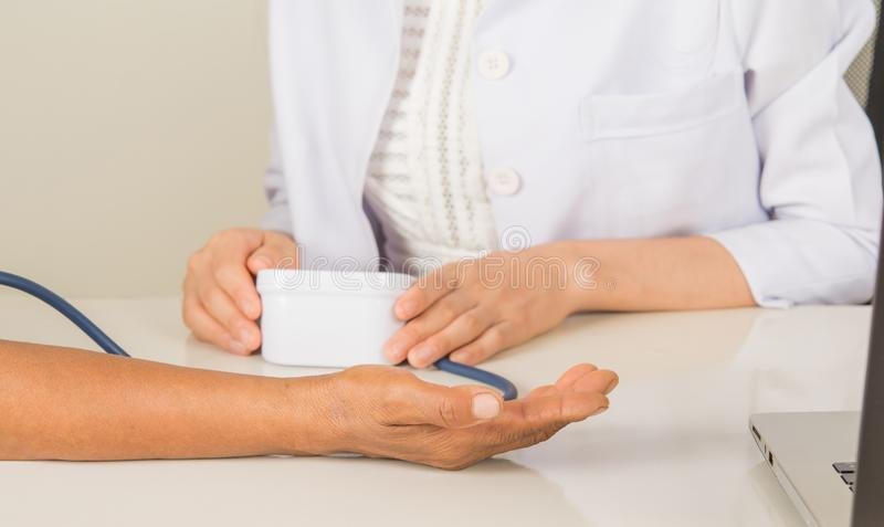 Doctor and doctor`s hand Blood pressure test Work stock images