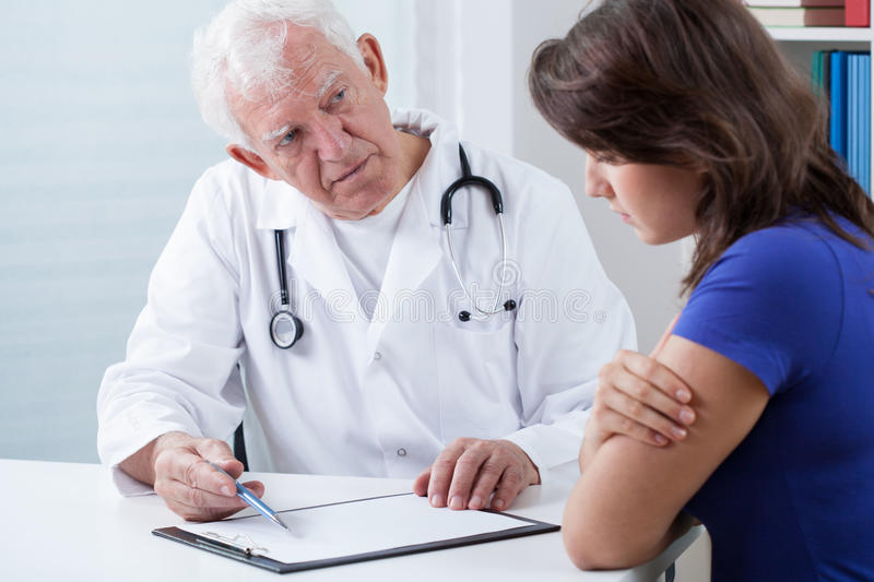 Doctor doing medical interview stock photo