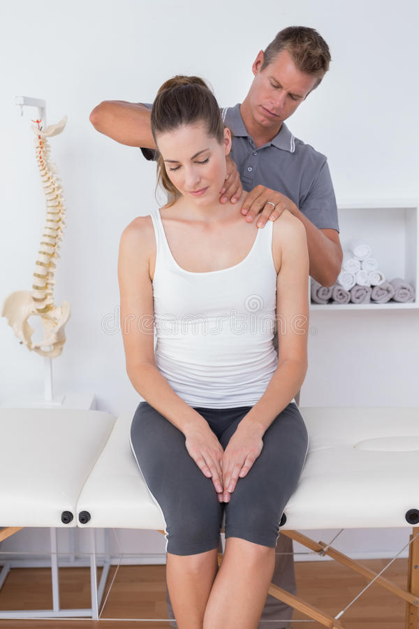 Doctor doing neck adjustment. In medical office royalty free stock photo
