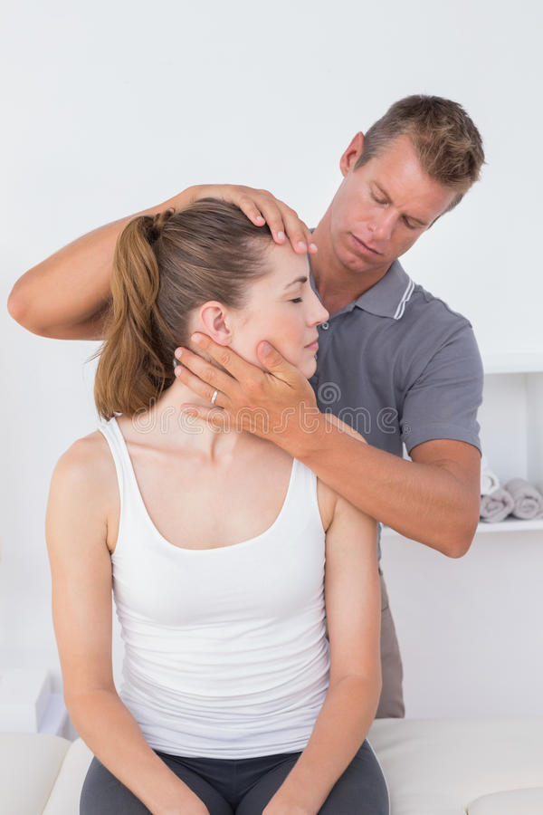 Doctor doing neck adjustment. In medical office royalty free stock images