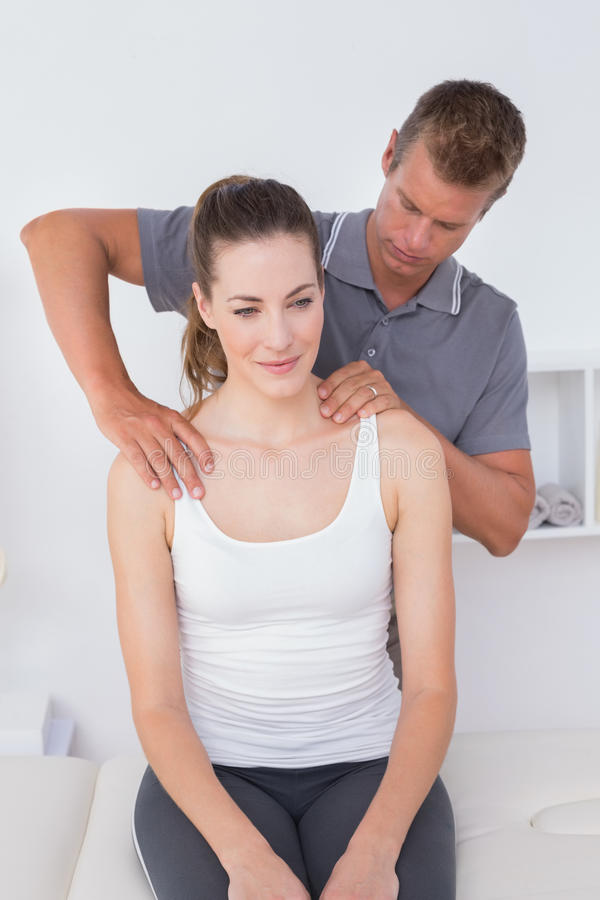 Doctor doing neck adjustment. In medical office stock photos