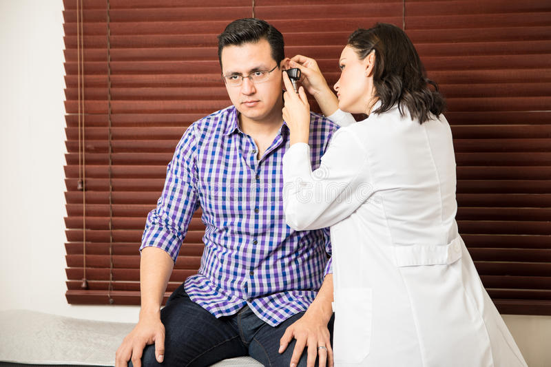 Download Doctor Doing A Physical Exam To Patient Stock Photo - Image: 83707731