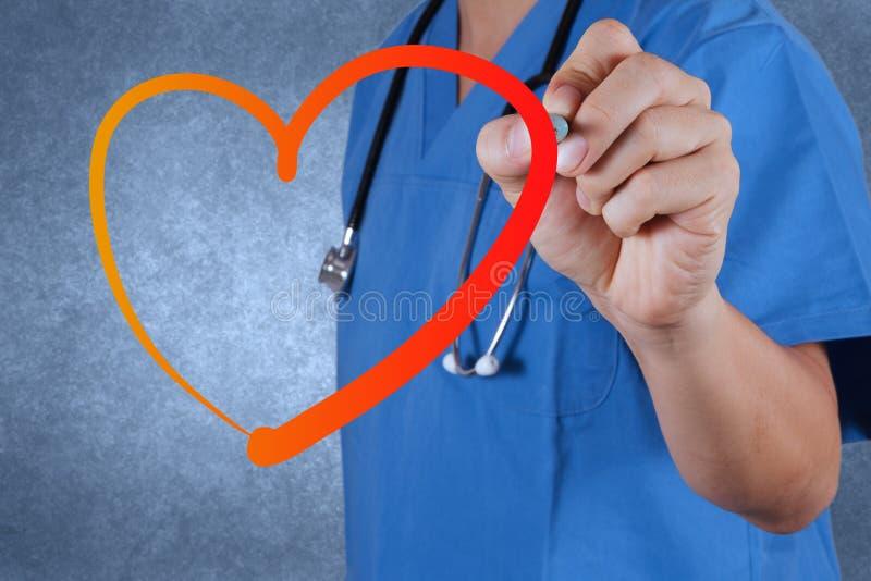 Doctor drawing heart symbol stock photos