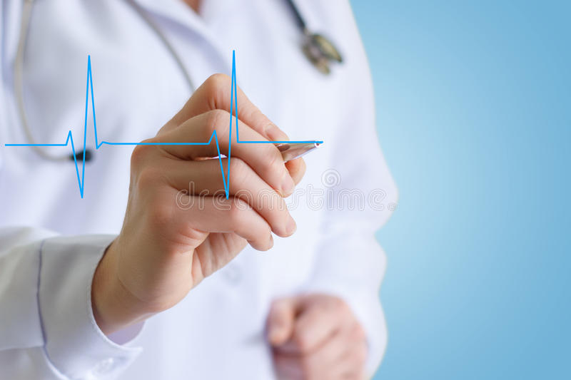 Doctor draws a cardiogram. royalty free stock image