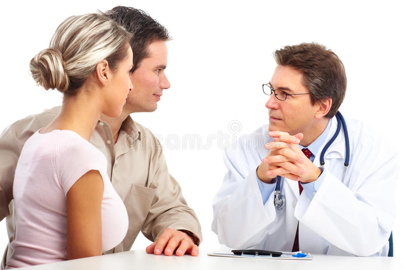 Doctor and elderly couple royalty free stock photo
