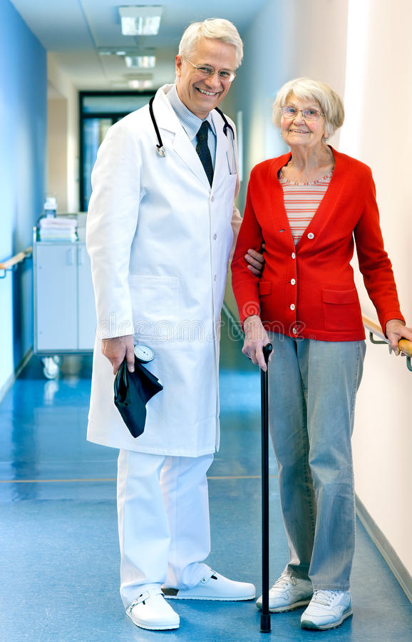 Doctor with an elderly woman patient in hospital. royalty free stock images