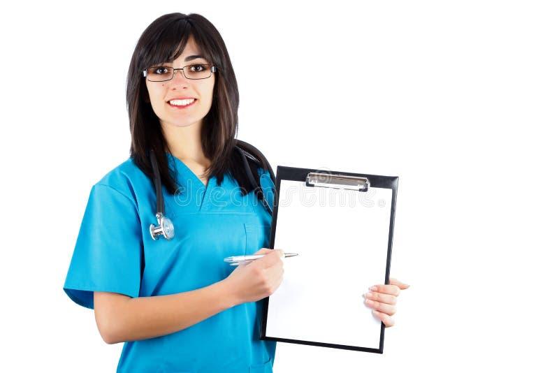 El doctor Pointing On Chart de la mujer foto de archivo libre de regalías