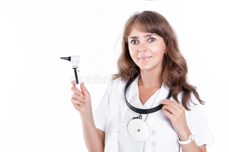 Doctor ENT is holding the Otoscope. Otolaryngologist in white coat stock photo