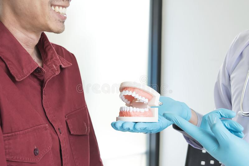 The doctor examined the patient`s symptoms and found that the toothache had disappeared royalty free stock photography