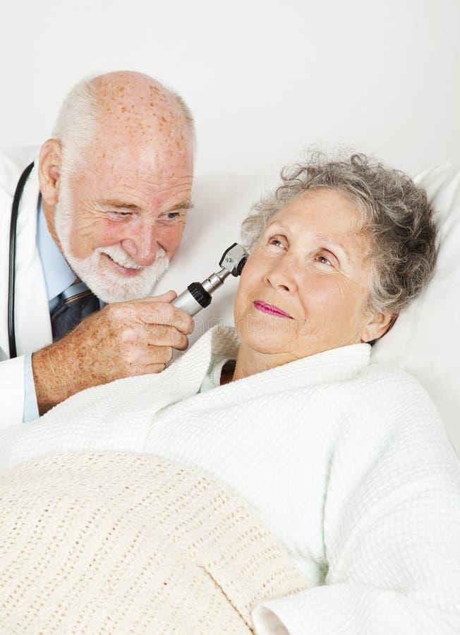 Doctor Examines Hospital Patient stock photo