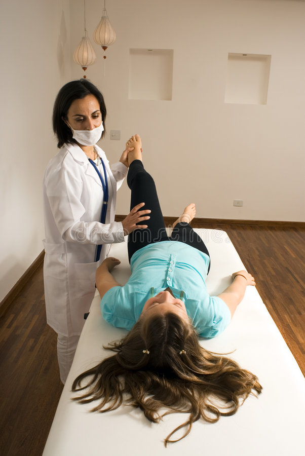 Doctor Examines A Patient S Leg-Vertical Royalty Free Stock Photography