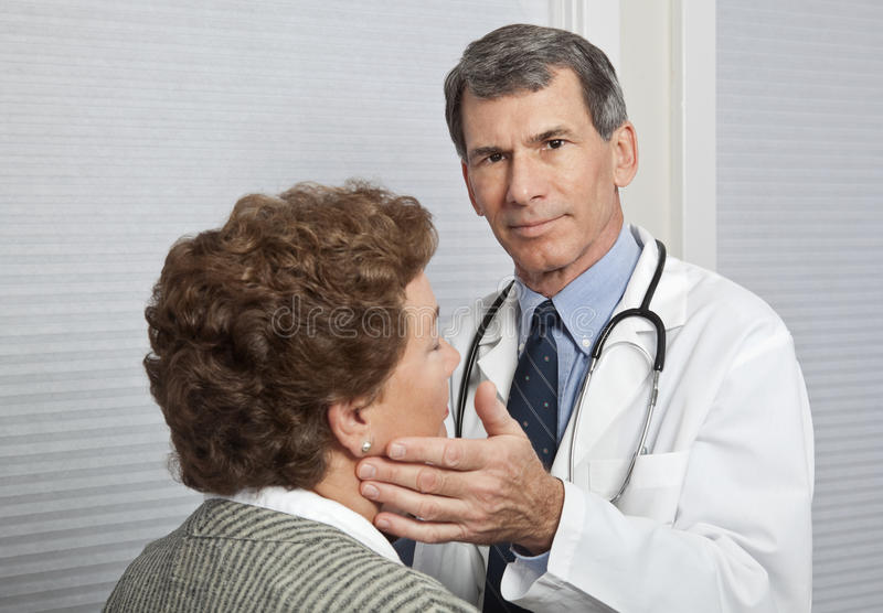 Download Doctor Examining Female Patient For Flu Symptoms Stock Photo - Image: 12335664