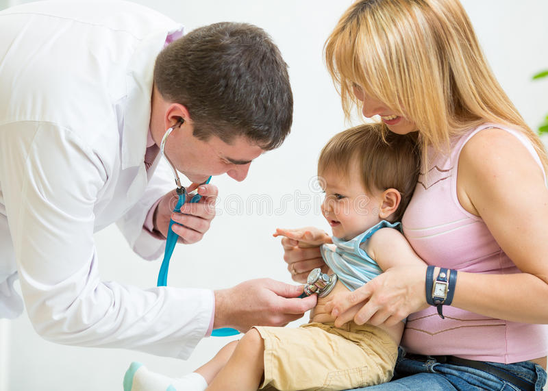 Doctor examining kid patient with stethoscope stock photo