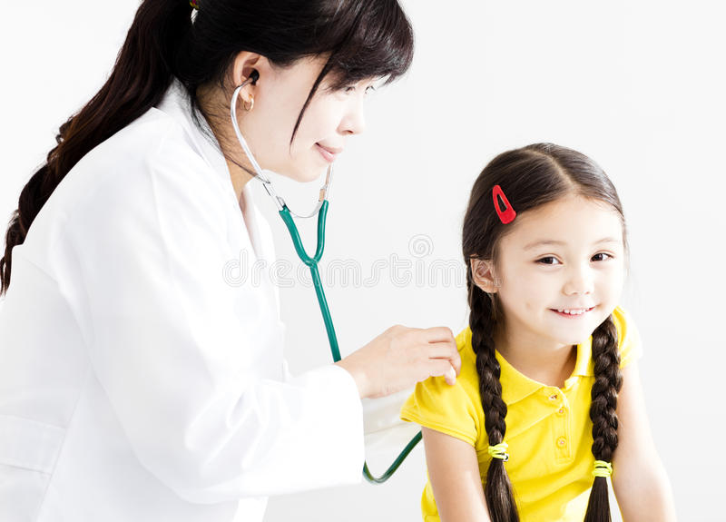 Doctor examining little girl by stethoscope stock photo