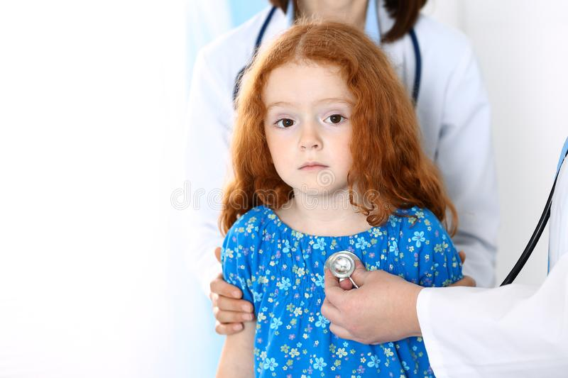 Doctor examining a little girl with stethoscope.Medicine and healthcare concept.  royalty free stock images