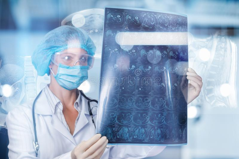 A doctor is examining a magnetic resonance imaging scan stock image
