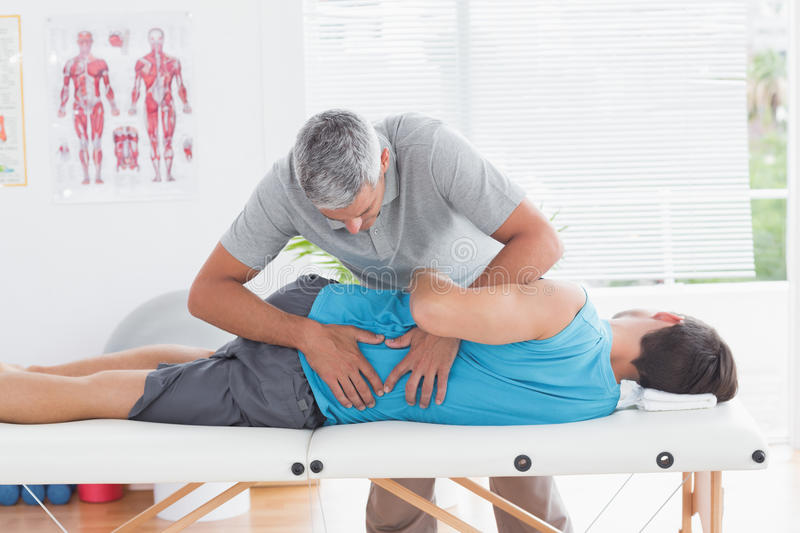 Doctor examining man back royalty free stock images