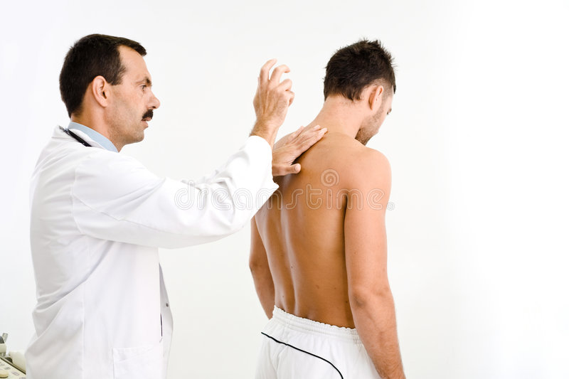 Doctor examining patient stock photography