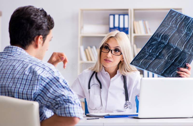 Doctor examining x-ray images of patient stock photography