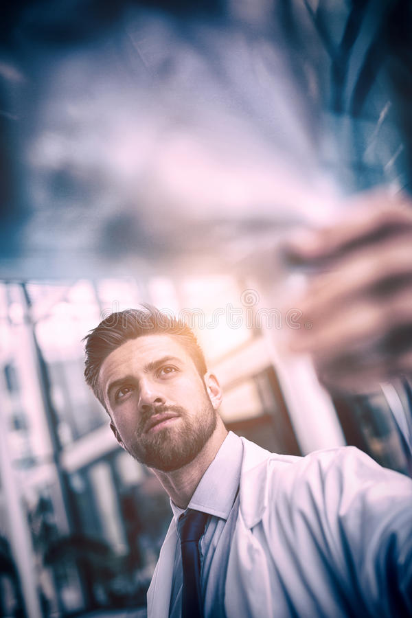 Doctor examining X-ray report. Close-up of doctor examining X-ray report in hospital royalty free stock photos
