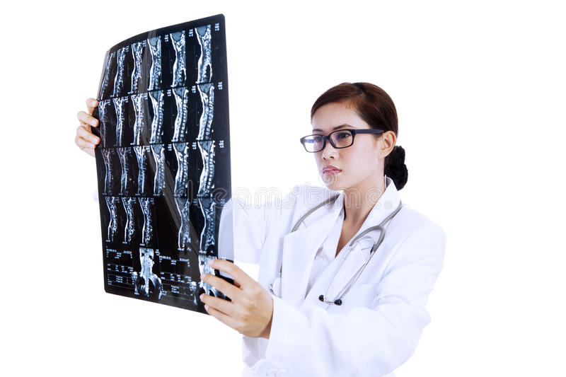 Download Doctor Examining X-ray Results Stock Photo - Image: 27060862