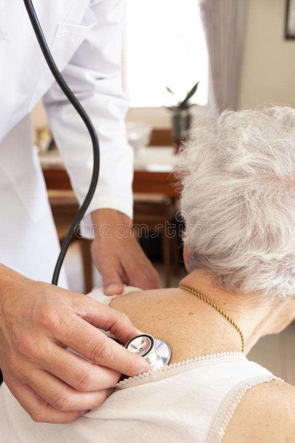 Doctor examining a senior woman stock photography