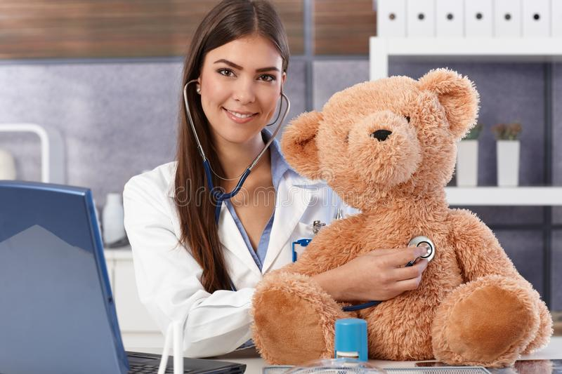 Download Doctor Examining Teddy Bear Stock Image - Image: 26802331