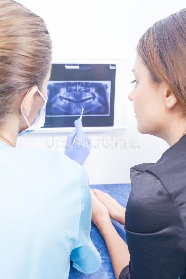 Doctor explaining dental xray stock photos