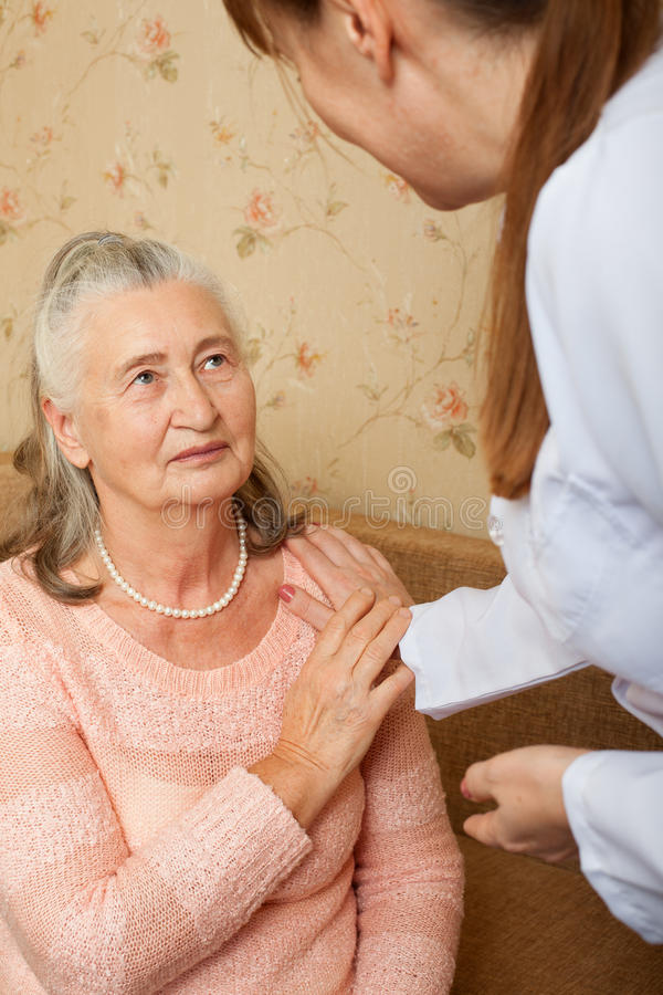 Doctor explaining diagnosis to his female patient royalty free stock photography