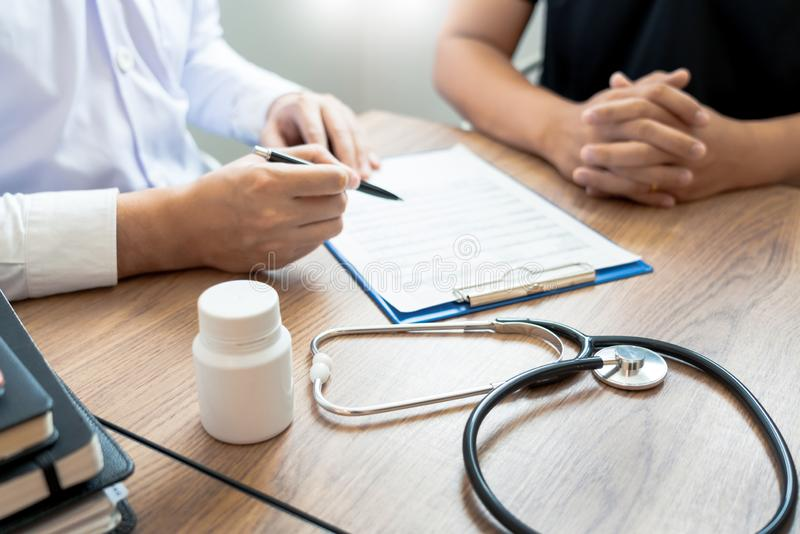 Doctor explaining and giving a consultation to a patient medical informations and diagnosis about the treatment for condition in. Hospital, medical ethics stock photos