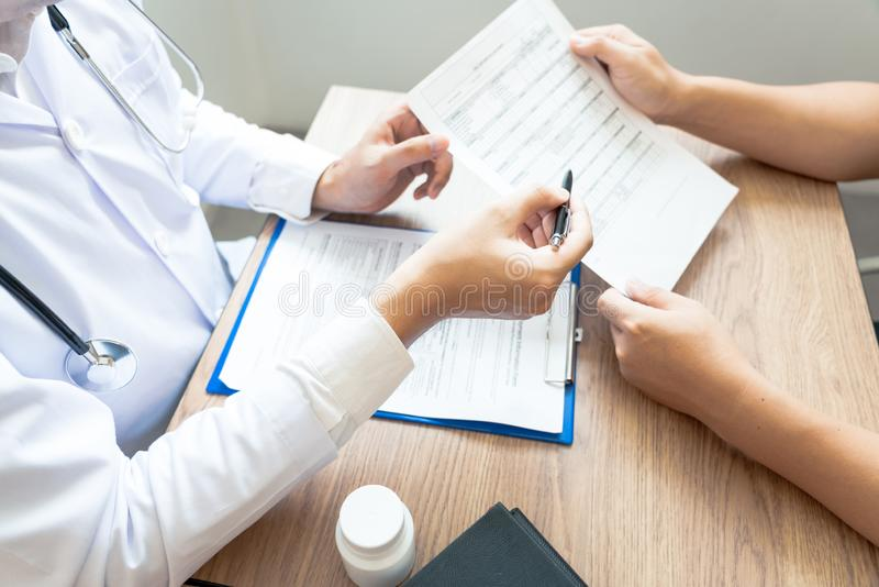 Doctor explaining and giving a consultation to a patient medical informations and diagnosis about the treatment for condition in. Hospital, medical ethics royalty free stock photo