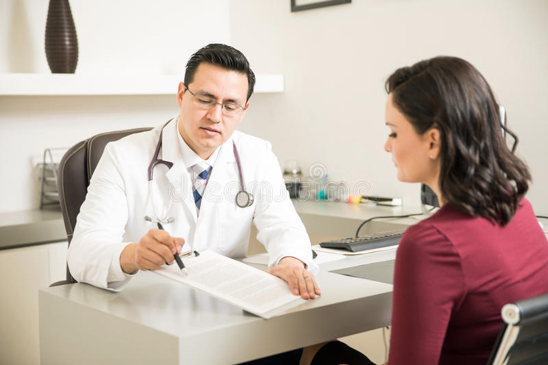 Doctor explaining information to patient stock photography