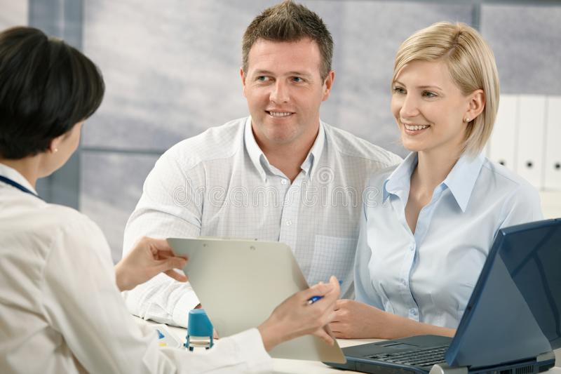 Doctor explaining medical diagnosis to patients stock photo
