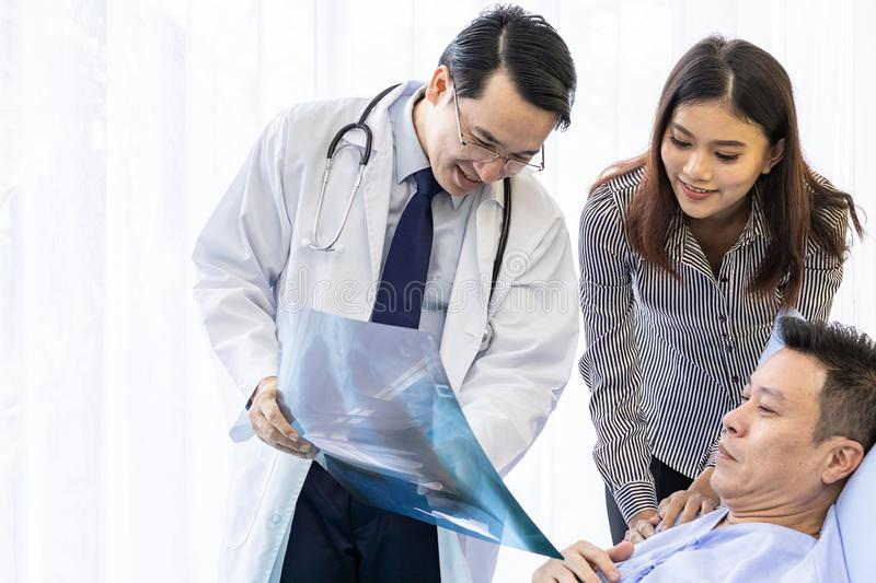 Doctor explaining x-ray results stock images