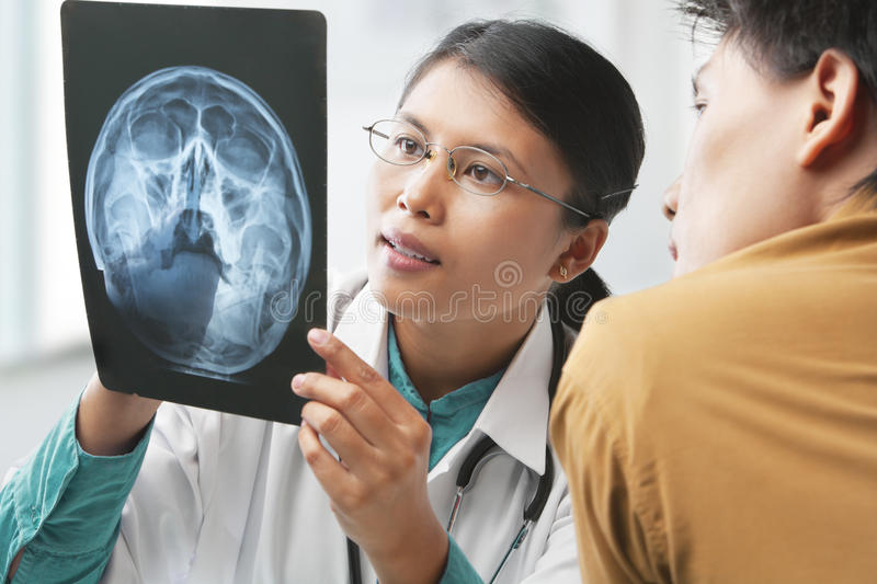 Doctor explaining skeleton xray to patient