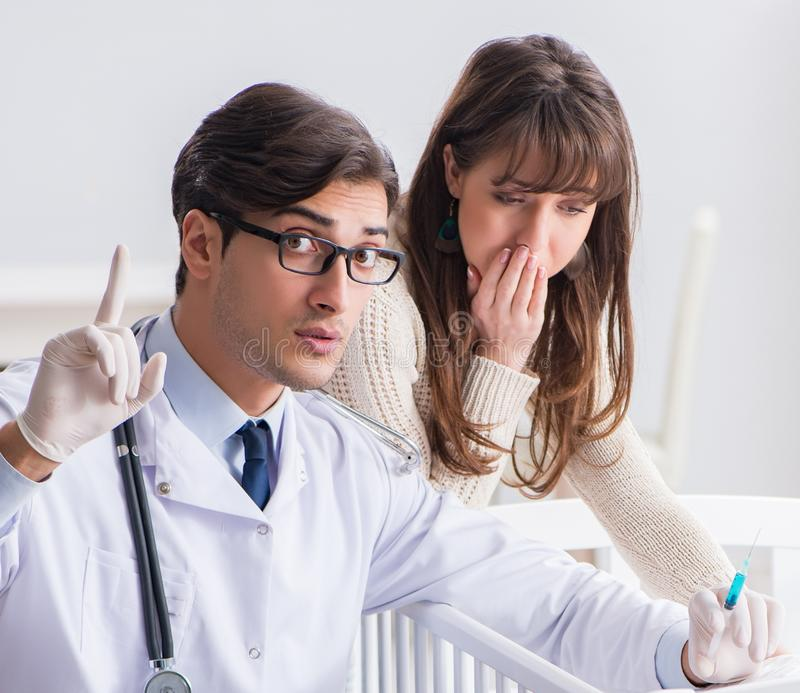 Doctor explaining to young mother. The doctor explaining to young mother stock image